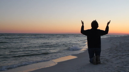 Kneeling In Prayer At Sunset