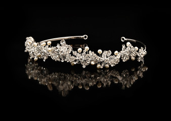 Diamond diadem on a black background with reflexion