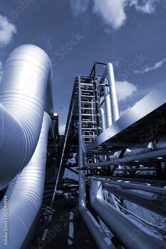 industrial pipelines on pipe-bridge in blue tone