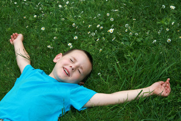 Kid lying on grass