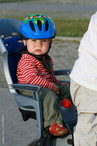 baby in bicycle chair