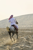 Arab Man Riding A Horse In The Desert