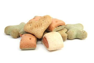 pile of funny shaped dog cookies over white background