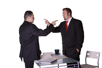 Businessmen Fighting Across the Desk