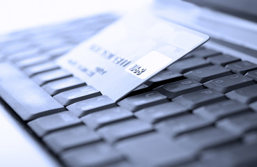 Credit card and laptop. Shallow DOF.