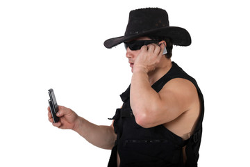 Man in black cap with phone