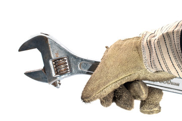 Dirty leather gloves and monkey wrench