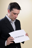 upset man looking to unemployed message poster