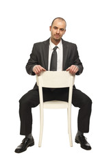 man sit on chair
