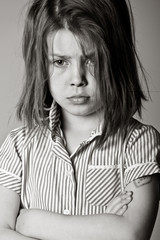 Powerful Black and White Shot of a Young Bullied Schoolgirl