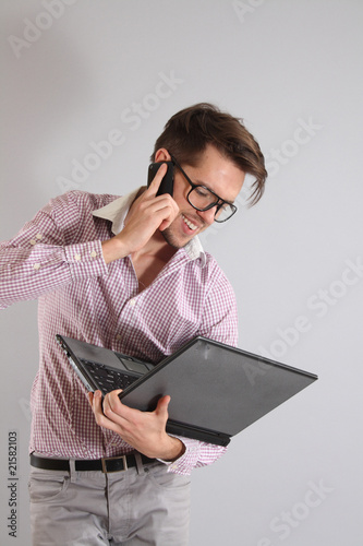 a young man with a phone and laptop