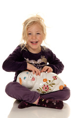 Save a child with a piggy bank with money bills