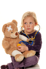 Child with a stethoscope as a doctor.
