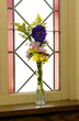 Flowers in window sill