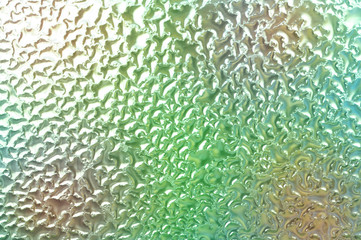 Condensation on glass with color in background