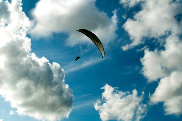 Paragliding in cloudy sky