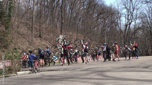 Mountain bikers celebrate victory by holding bikes over heads