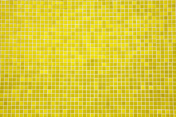 yellow mosaic tiles on a wall
