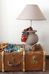 lamp, beads and old suitcase