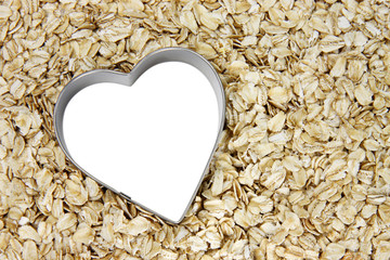 white heart outlined with silver on a bed of oatmeal