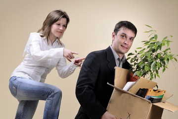 satisfied woman pushing her fired boss