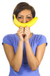Young ethnic woman with a banana smile