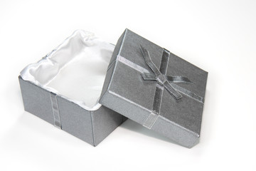 open silver gift box with ribbon and bow