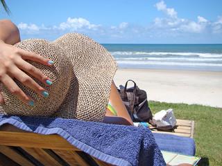 woman sunbathing looking to the beautiful sea