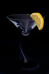 Martini glass on black with lemon