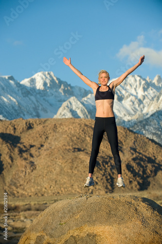 Woman jumps on rock