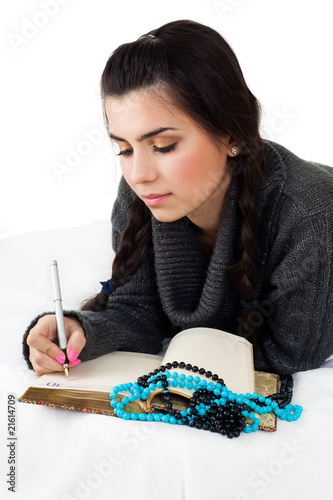 young woman write memories
