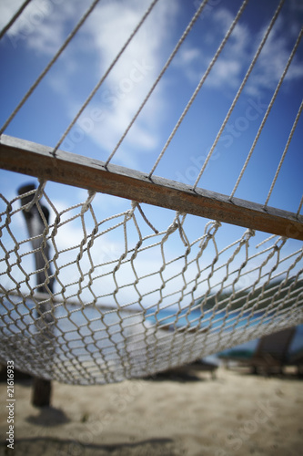 empty hammock on a sandy beach