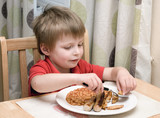 Young child eating unhealthy food. poster