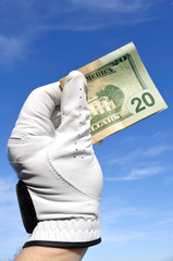 Golfer Holding a Twenty Dollar Bill