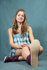 teenager girl  sitting on grey