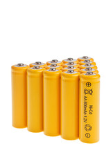 Rechargeable AA size accumulators over white background.