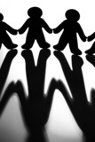 Black And White Image Of Silhoutted Figures Joining Hands poster