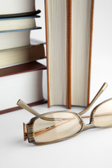 Eyeglasses and books