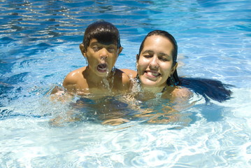 Boy and Woman in Pool