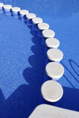 blue swimming pool round tiles way