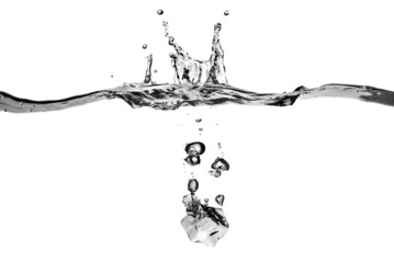 ice cube dropped into water with splash isolated on white