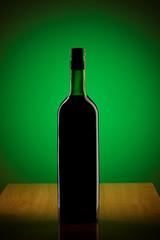 Wine against colour gradient background