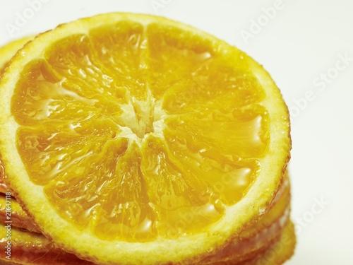 Fotobehang Plakjes fruit Nahaufnahme einer Orangenscheibe