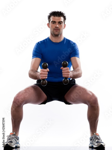 man doing workout squats on white isolated background