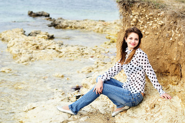 teen smiling girl on the sea coast