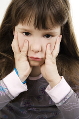 Upset little girl on white background