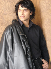 portrait of a young indian man wearing leather jocket