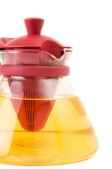 glass teapot isolated on a white background. Green tea