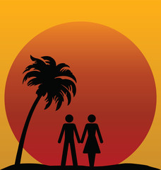 Couple silhouetted against a tropical sunset or sunrise