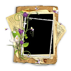 beautiful spring frame with crocuses on the old paper stack